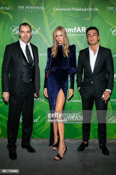 Gatsby Milutin model Kirstin Liljegren and a guest attend the amfAR Paris Dinner 2018 at The Peninsula Hotel on July 4 2018 in Paris France