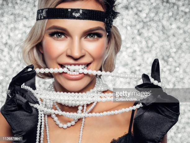 gatsby style - roaring 20s party stock photos and pictures