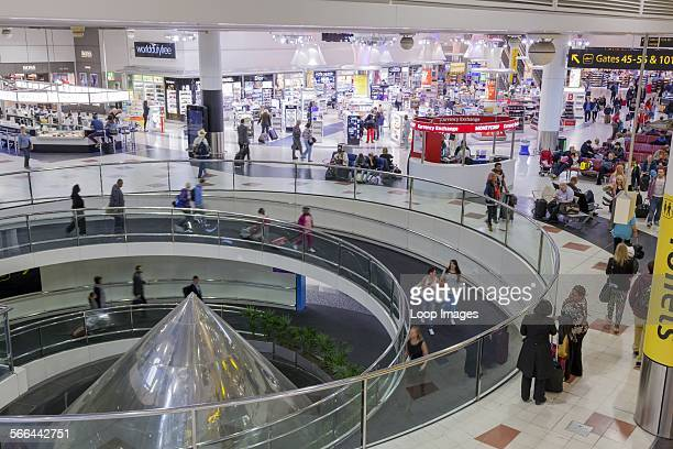 Gatwick airport departure lounge spiral ramp and shops