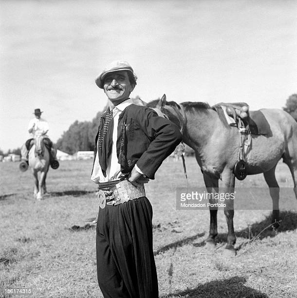 A gaucho smiles at the camera gauchos are the typical South American cattlemen the equivalent of North American cowboys found in the pampas in parts...