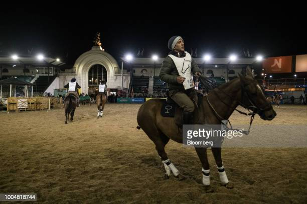 Gauchos ride horses in a show ring during La Exposicion Rural agricultural and livestock show in the Palermo neighborhood of Buenos Aires Argentina...