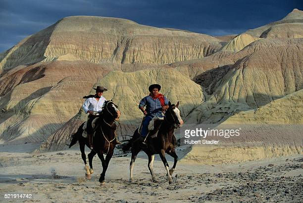 Gauchos Ride Through Petrified Forests
