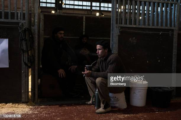 Gauchos sit and drink mate at the equine pavilion during La Exposicion Rural agricultural and livestock show in the Palermo neighborhood of Buenos...
