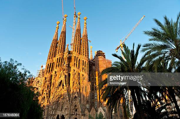 Gaudí cathedral Sagrada Família sunrise on golden spires Barcelona Spain