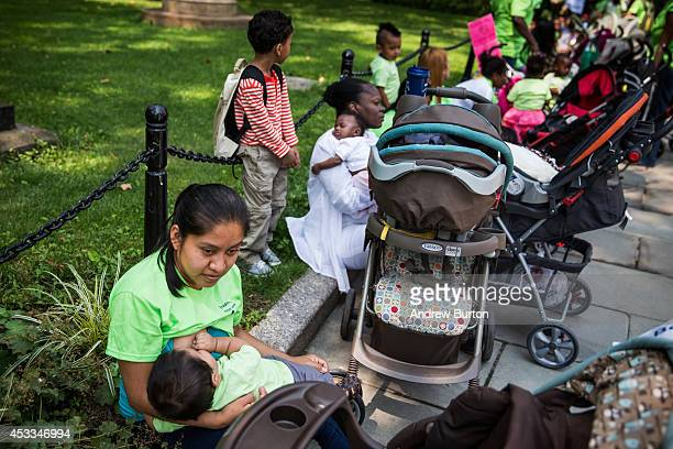 Gaudelia Figueroa breastfeeds her 9monthold son Alex Oropeza outside City Hall during a ralley to support breastfeeding in public on August 8 2014 in...