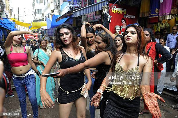 Gaudily dressed eunuchs dancing during a Bhujariya procession taken out on the third day of Raksha Bandhan on August 31, 2015 in Bhopal, India. On...