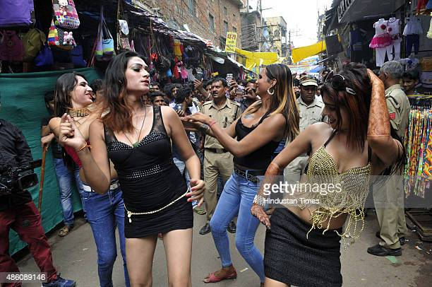 Gaudily dressed eunuchs dancing during a Bhujariya procession taken out on the third day of Raksha Bandhan on August 31 2015 in Bhopal India On this...
