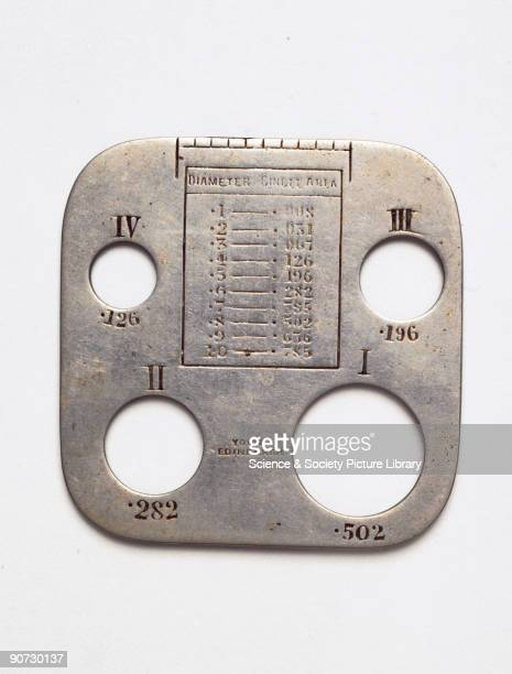 A gauge for measuring the size of smallpox pustules made by Young's of Edinburgh The doctor could relate a patient's pustules to four typical sizes...