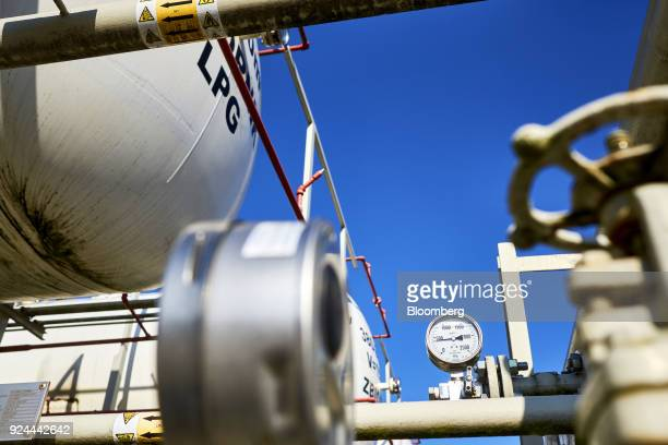 A gauge indicates the pressure level of liquid petroleum gas on pipework near a storage tank at the natural gas and crude oil mine operated by...