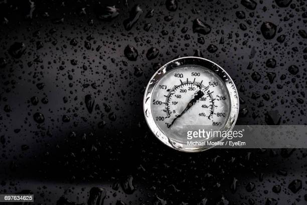 Gauge On Wet Glass During Rainy Season