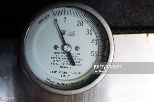A gauge shows how hot the boiling maple syrup is in the evaporator inside the maple syrup shed March 28 2006 in Bowdoin Maine Penny Savage and Earle...
