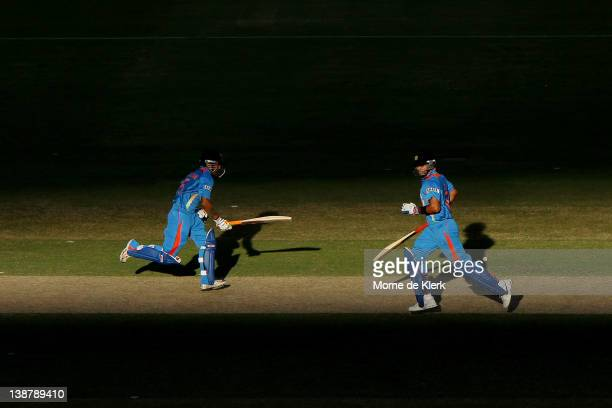 Gautam Gambhir and Virat Kohli of India run between the wickets during game four of the One Day International Series between Australia and India at...