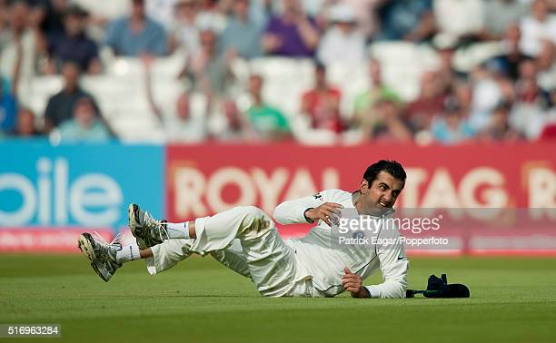 Gautam Gambhir of India falls to the ground after dropping a catch off Kevin Pietersen of England during the 4th Test between England and India at...