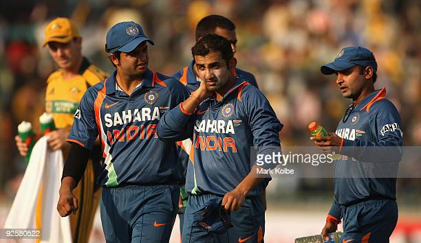 Gautam Gambhir of India leaves the field after being hit in the neck with the ball while fielding during the third One Day International match...