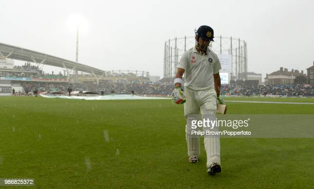 Gautam Gambhir of India leaves the field the after being run out as rain interrupts play during the 5th Test match between England and India at The...