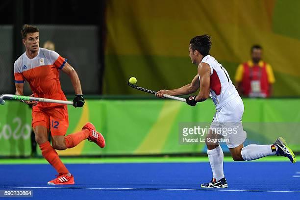 Gauthier Boccard of Belgium controls the ball in the air as Sander De Vinj of the Netherlands runs during the Men's semifinal hockey match Belgium vs...