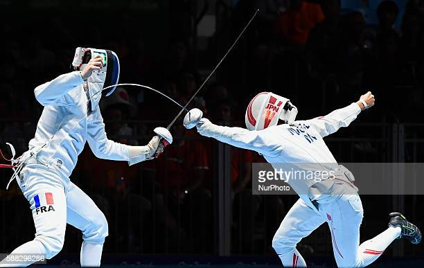 Gauthier Grumier of France competes with Kazuyasu Minobe of Japan during the men's epee individual quarterfinal of fencing at the 2016 Rio Olympic...