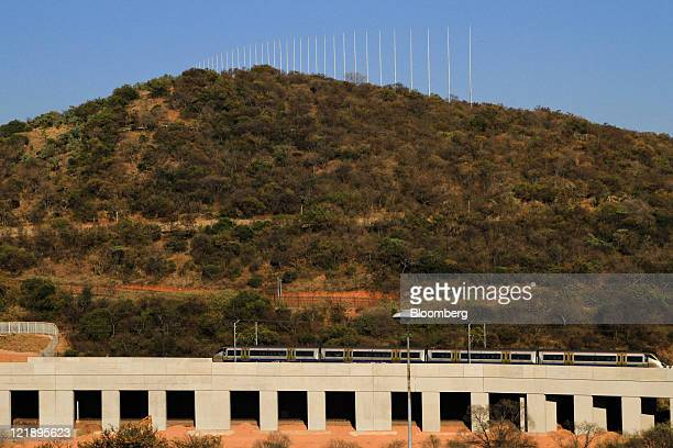 A Gautrain passenger train travels through the outskirts of Pretoria South Africa on Tuesday Aug 23 2011 South Africa expanded its rapidrail line...