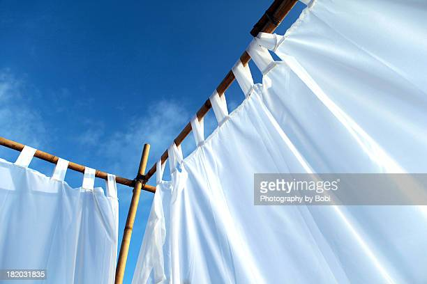 gauze curtain under the blue sky - hainan island stock pictures, royalty-free photos & images