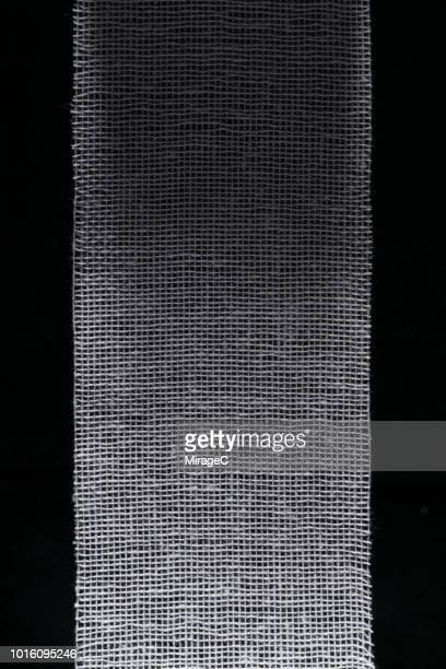 gauze texture on black - gauze stock pictures, royalty-free photos & images