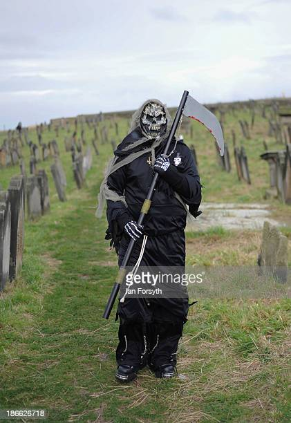 Gav Woodward who works as a distribution driver from Middlesbrough dressed as a grim reaper visits the Goth weekend on November 2 2013 in Whitby...