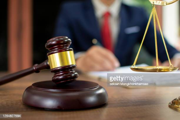 gavel and law book in front of lawyer - guilt stock pictures, royalty-free photos & images
