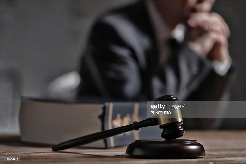 Gavel and law book in front of lawyer : Stock-Foto