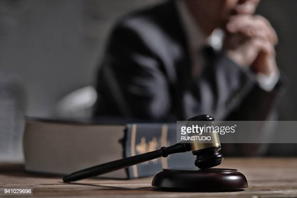 gavel and law book in front of lawyer - penalty stock pictures, royalty-free photos & images