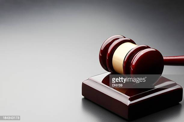Gavel and sound block on gray background
