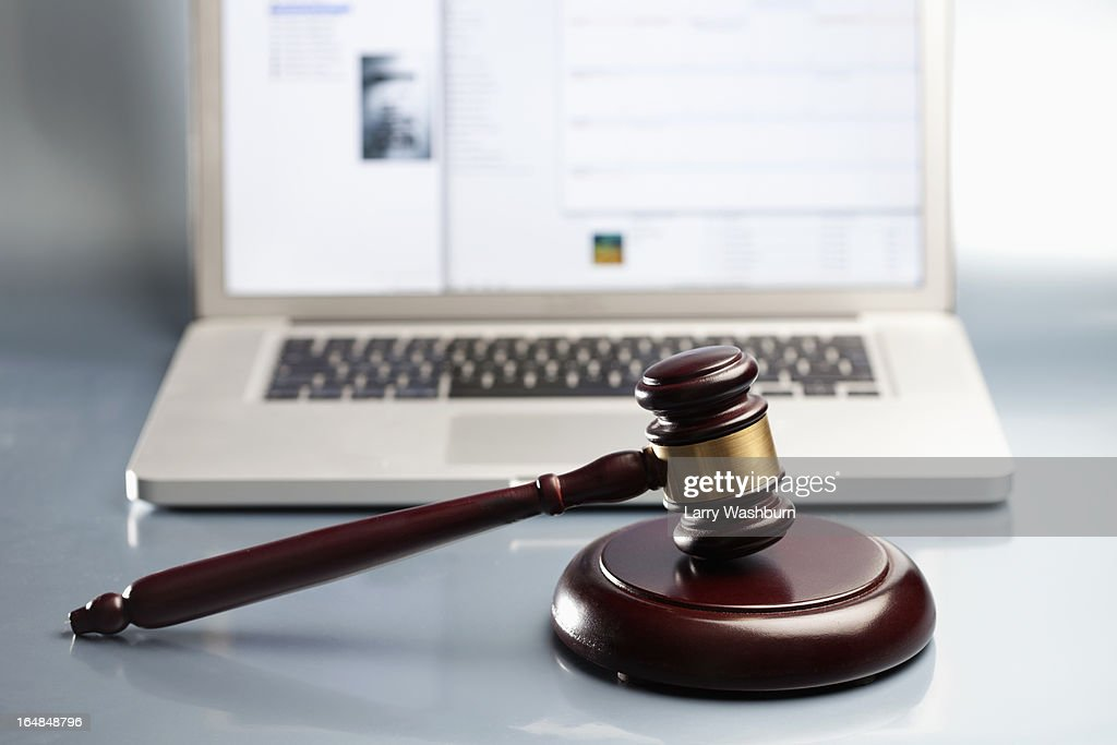 Gavel and sound bock in front of hammer : Stock Photo