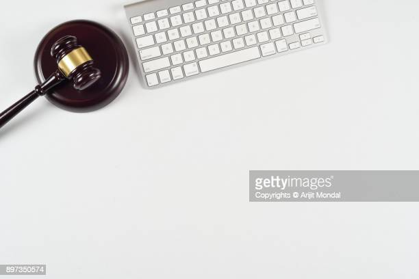 Gavel and sound bock with computer keyboard online auction in white background and copy space