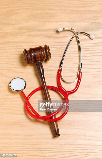 gavel and stethoscope/malpractice - medical malpractice stock photos and pictures