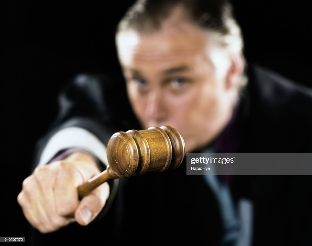 Gavel is held out as a threat by angry judge : Stock Photo