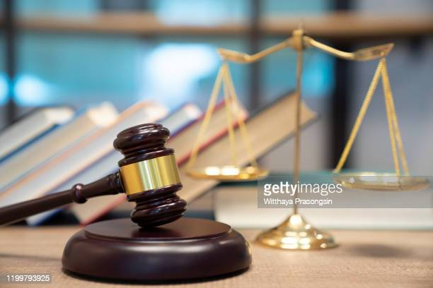 gavel on desk. isolated with good copy space. dramatic lighting. - legal trial stock pictures, royalty-free photos & images