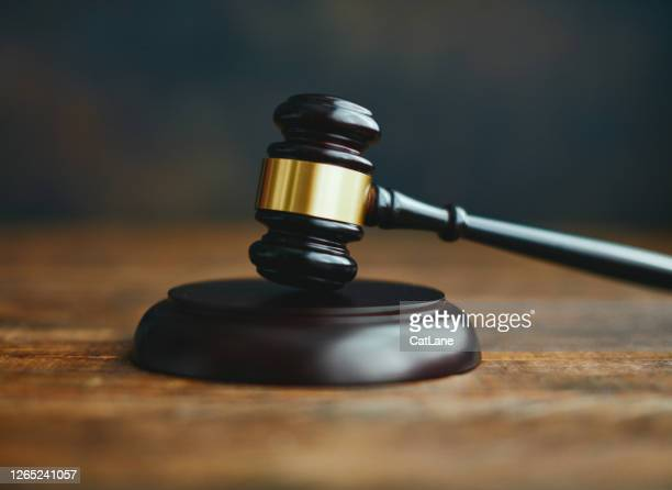 gavel on desk - penalty stock pictures, royalty-free photos & images