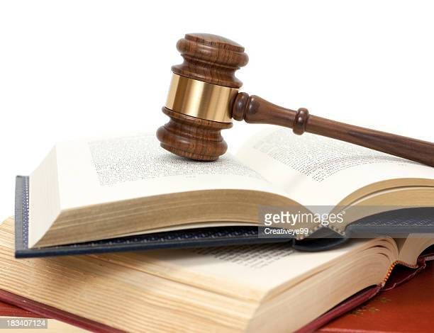 gavel on open books - gavel stock pictures, royalty-free photos & images