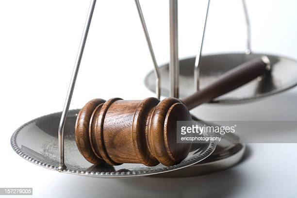 Gavel on silver scale of justice