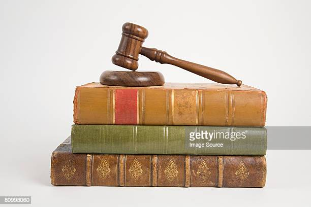 A gavel on top of books