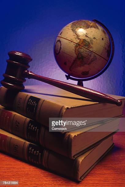 gavel on top of legal books with globe - 国際法 ストックフォトと画像
