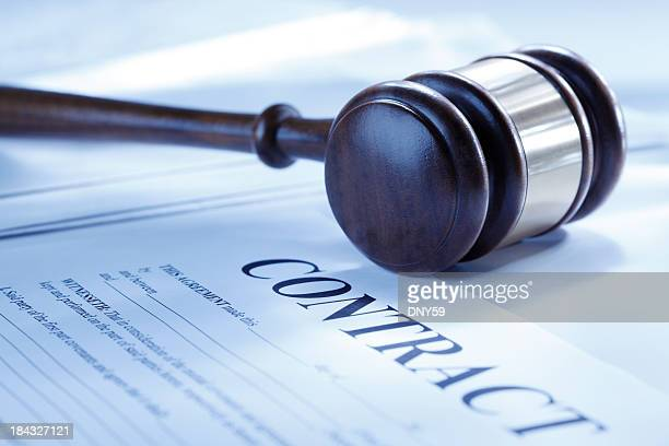 Gavel resting on an unsigned contract