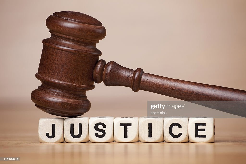 Gavel Resting on the Word Justice : Stock Photo