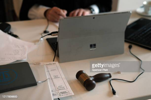 Gavel sits on the table as New York City Criminal Court Judge Paul McDonnell works remotely from his Brooklyn apartment due to the coronavirus...