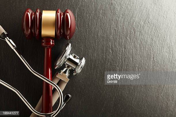 gavel & stethoscope - medical malpractice stock photos and pictures