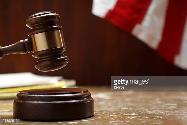 Gavel striking sound block in a courtroom