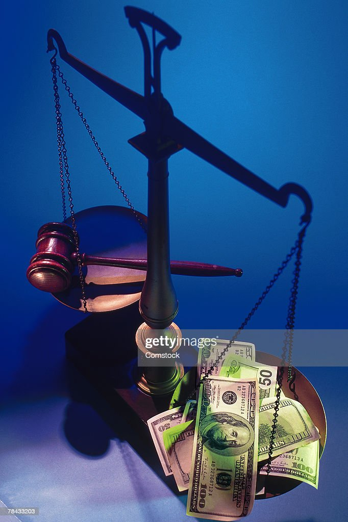 Gavel versus cash on scales of justice : Stock Photo