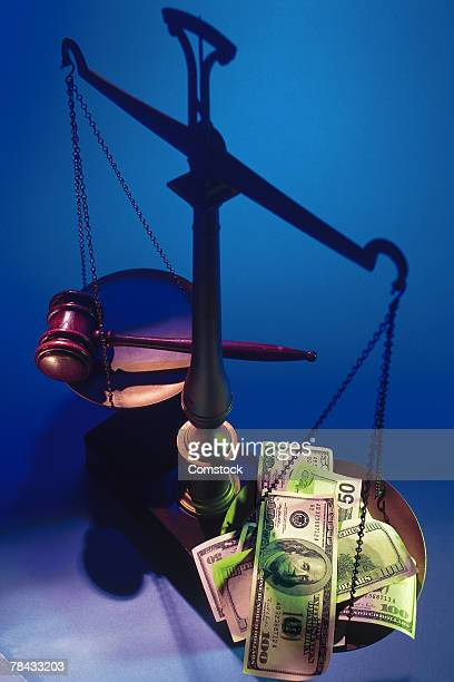 Gavel versus cash on scales of justice