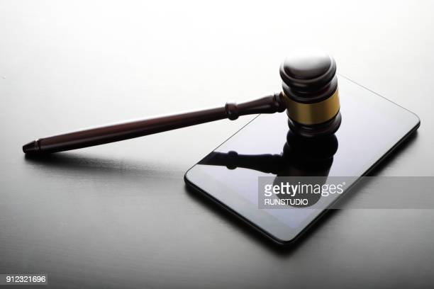 gavel with digital tablet - lawsuit stock pictures, royalty-free photos & images