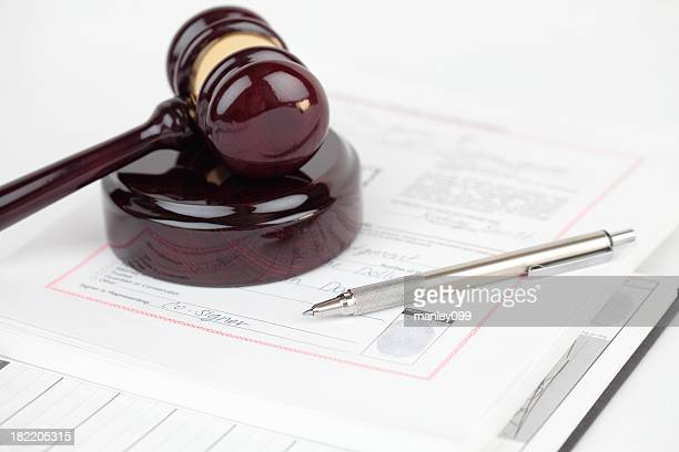 gavel with documents and pen