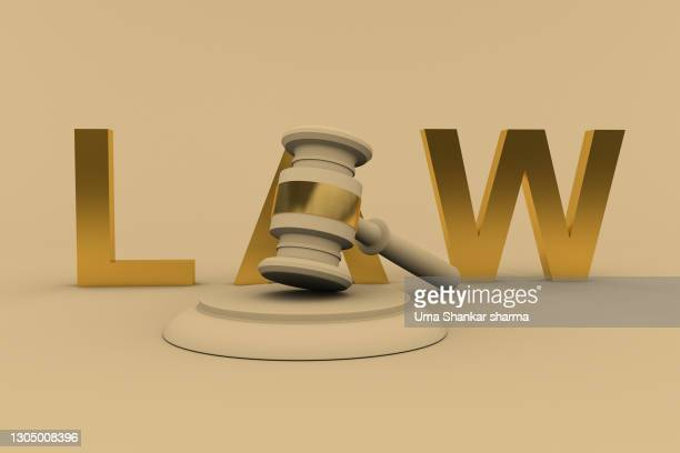 gavel with law text against off  white background - court room stock pictures, royalty-free photos & images