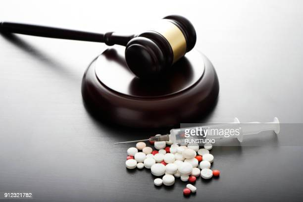 Gavel with medicine and syringe